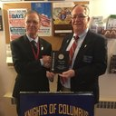 "On Thursday November 29, 2019 at Holy Martyr's Church our District Deputy Brother Ray DiDonato presented Grand Knight Michael Crowley a ""Supreme Award"" for our completion of the 2018-2019 Faith in Action Program. We would like to thank our Religious, Parish Office Staff, Parishioners, and our Council members and their Family members for all their help in receiving this award."
